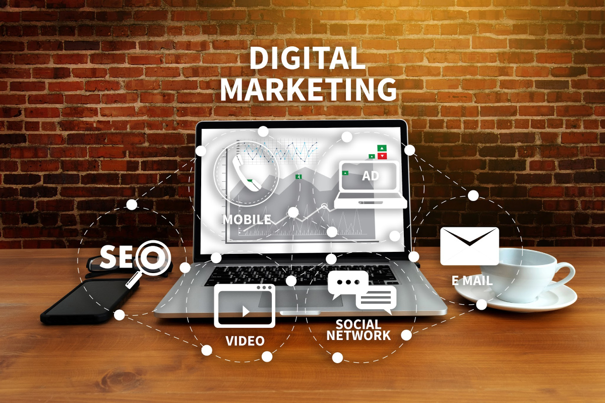 DIGITAL MARKETING new startup project MILLENNIALS Business team hands at work with financial reports and a laptop